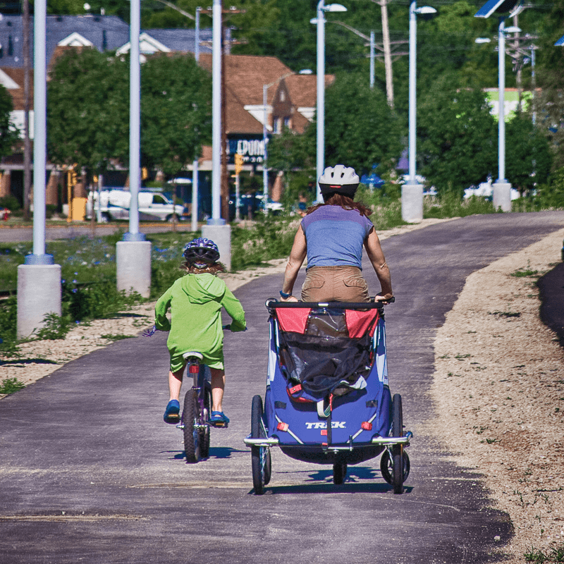 Family bike ride on a bike path