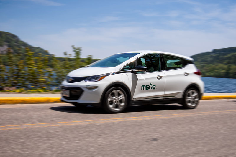 Ride along in an all-electric vehicle with a driving range of 238 miles on a single charge.