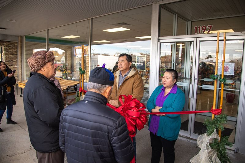 Kyle Lee (pictured left) owns Madison Oriental Market. His daughter, Cynthia Lee, runs the store with assistance from his wife, Choua Lee (pictured right).